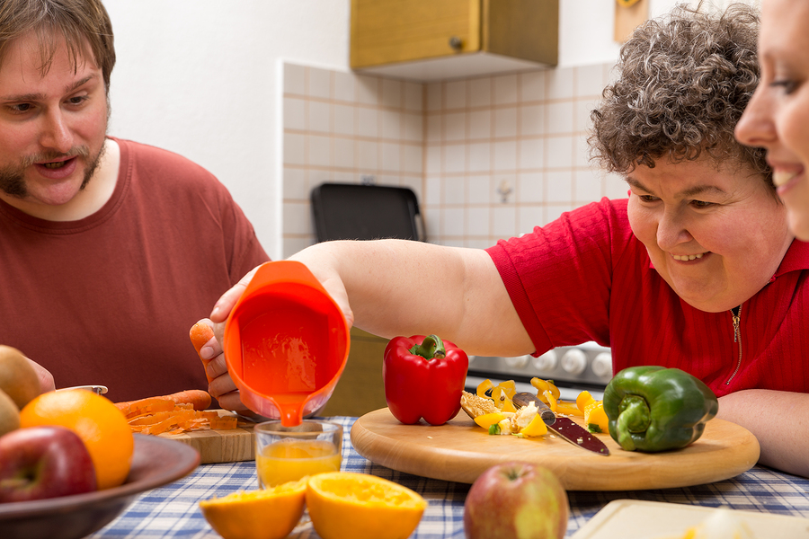 Mentally disabled woman being supported to cook on her own